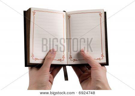 Hands Holding A Vintage Journal