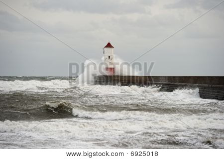 Wave Breaking Over Lighthouse, Berwick Upon Tweed, Northumberland, England, Uk