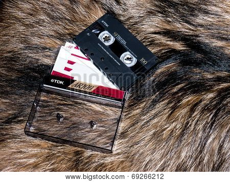 GOMEL, BELARUS - JUNE 11, 2014: TDK cassette tape  on fur background. TDK Corporation, is a Japanese multinational electronics company that manufactures electronic materials, and data-storage media.