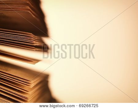 Close-up of the scattered pages of an old open book, concept of literature and knowledge, with copy space on beige background