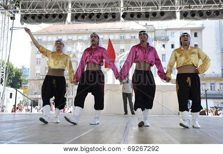 ZAGREB, CROATIA - JULY 17: Members of folk groups Egyptian National Folklore Troupe from Egypt during the 48th International Folklore Festival in center of Zagreb,Croatia on July 17, 2014