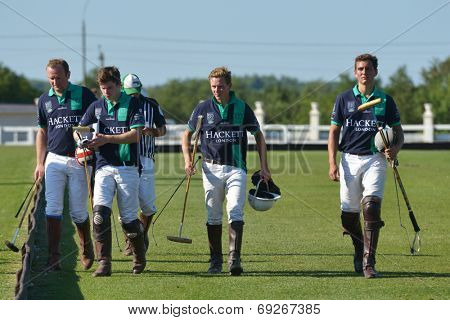 TSELEEVO, MOSCOW REGION, RUSSIA - JULY 26, 2014: Oxbridge Polo Team after the match against the Tseleevo Polo Club during the British Polo Day. Oxbridge won 5-4