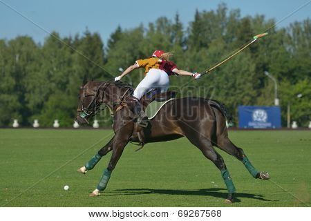 TSELEEVO, MOSCOW REGION, RUSSIA - JULY 26, 2014: Aliona Chekhova of Tseleevo Polo club in action during the match against the Oxbridge polo team during the British Polo Day. Oxbridge won 5-4