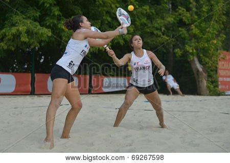 MOSCOW, RUSSIA - JULY 18, 2014: Marie-Eve (left) and Mathilde Hoarau of France in the match against Italy during ITF Beach Tennis World Team Championship. Italy won in two sets