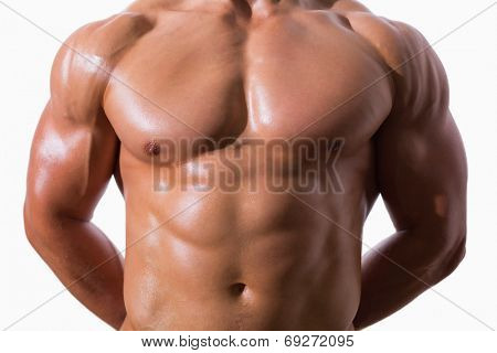 Mid section of shirtless muscular man standing over white background
