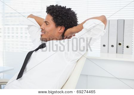 Businessman relaxing in his swivel chair in his office
