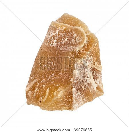 One piece of Beeswax close up  isolated on a white background