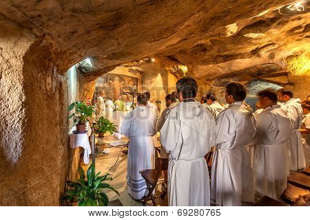 JERUSALEM, ISRAEL - JULY 13, 2014: Franciscan monks pray in Grotto of Gethsemane - chapel located in the cave near the Tomb of the Virgin Mary. This is the place where Judas Iscariot betrayed Jesus.