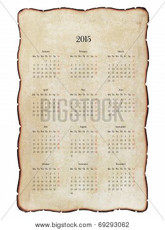 Old, Decrepit Calendar 2015 With Charred Edges, Grunge. Isolated On White.