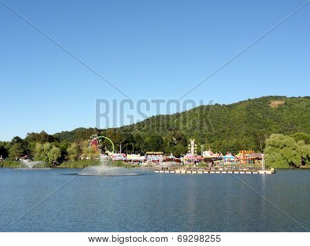 Amusement Park Rides Across Pond At The Marin County Fair
