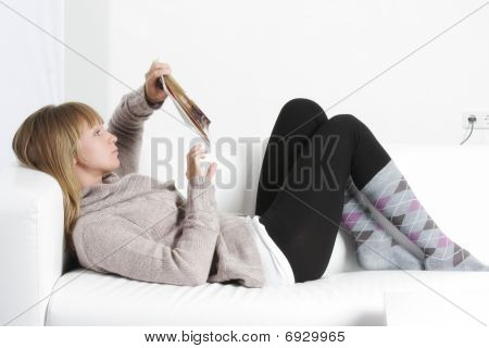 Woman Reading Book Laying On Back