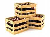 stock photo of crate  - Bottles in wooden crates isolted on white background - JPG