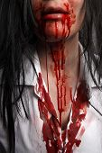 stock photo of bloody  - Closeup of a zombie nurse with bloody white shirt - JPG