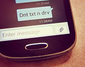 stock photo of unsafe  -  Cell phone message Don - JPG