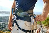 stock photo of harness  - Close up of a man in his harness and rock climbing equipment - JPG