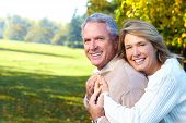 stock photo of couple  - Happy elderly seniors couple in park - JPG