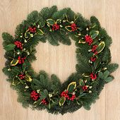 picture of mistletoe  - Winter and christmas floral wreath with holly - JPG