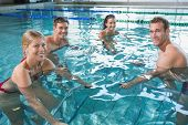 foto of day care center  - Fitness class doing aqua aerobics on exercise bikes in swimming pool at the leisure centre - JPG