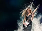 picture of guitar  - Beautiful young woman playing on electric guitar in water splashes - JPG