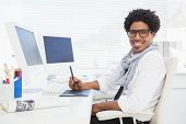 image of half-dressed  - Hipster businessman working at his desk in his office - JPG