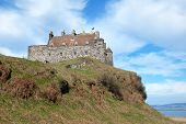 stock photo of bute  - Duart Castle is a castle on the Isle of Mull off the west coast of Scotland within the council area of Argyll and Bute - JPG