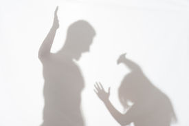 pic of wife-beater  - Silhouette of man striking the woman who cannot to protect herself - JPG