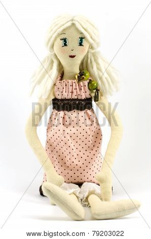 Rag-doll dressed in speckled pink dress