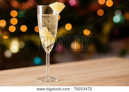 A glass of sparkling wine with pineapple