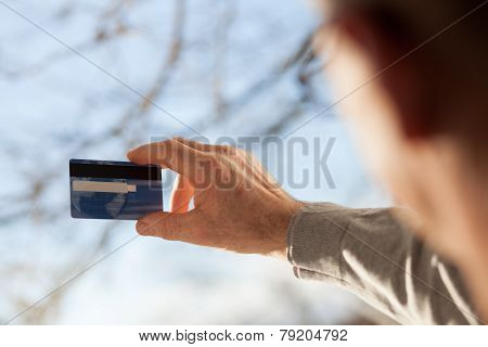 Senior Male Hands Holding A Plastic Card