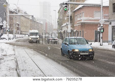 Snowy Winter Road With Cars Driving