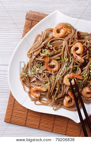 Soba Noodles With Shrimp On A Plate Close-up. Vertical