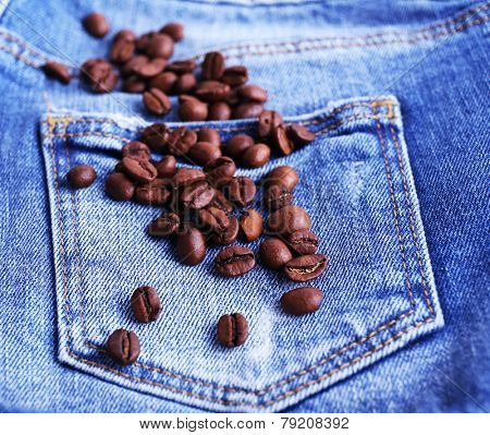 Coffee beans on the jeans background