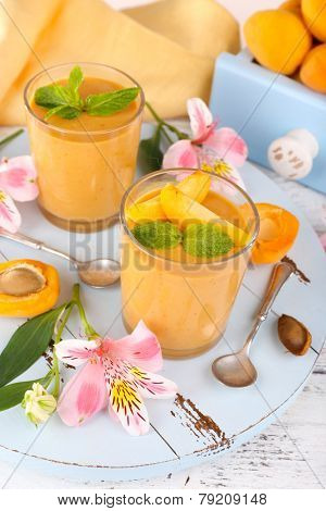 Apricot dessert in glasses on table close-up