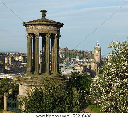 Edinburgh skyline and Dugald Stewart Monumentas seen from Calton Hill