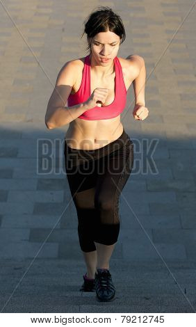 Fit young woman running upstairs