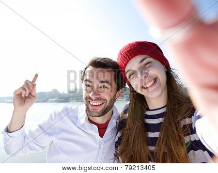 Young Man And Woman Taking Selfie On Mobile Phone