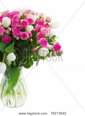bunch of  fresh pink roses and white tulips close up