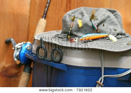 Closeup Of Fishing Tackle Box And Hat