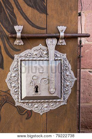 Antique Silver Door Lock On Timber
