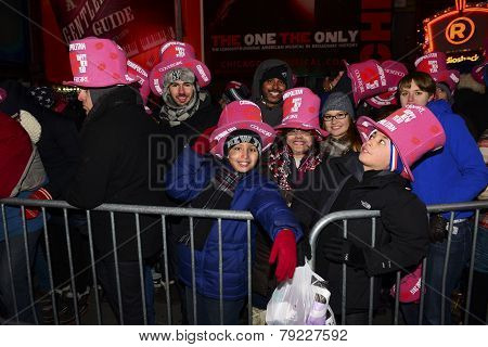 Kids with pink hats await countdown