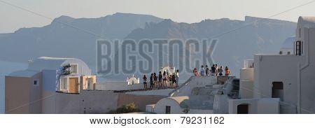 Tourists on roof tops Santorini