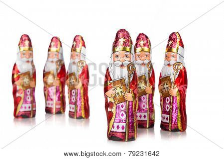 Close up of Sinterklaas. Saint  Nicholas chocolate figure of  Dutch character of Santa Claus.Isolated on white background.