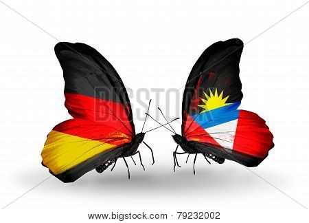 Two Butterflies With Flags On Wings As Symbol Of Relations Germany And Antigua And Barbuda