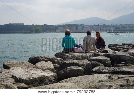 GENEVA - SEP 11: people rest near Geneva lake on September 11, 2014 in Geneva, Switzerland. Geneva is the second most populous city in Switzerland and is the most populous city of Romandy