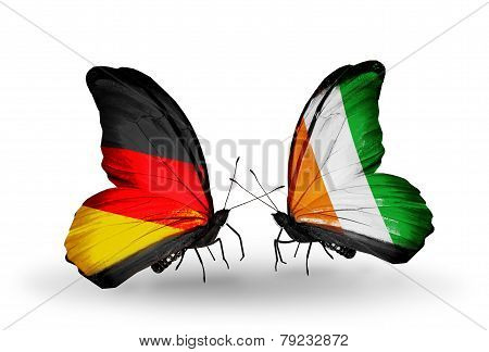 Two Butterflies With Flags On Wings As Symbol Of Relations Germany And Cote Divoire