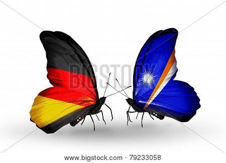 Two Butterflies With Flags On Wings As Symbol Of Relations Germany And Marshall Islands