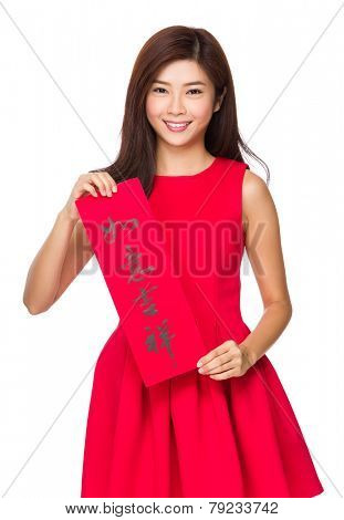 Chinese Woman hold with fai chun, phrase meaning is everything goes smooth and good luck