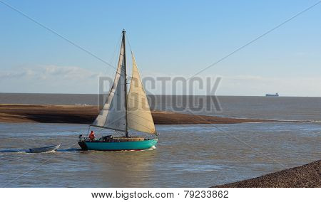 Yacht negotiating the difficult estuary of the river Deben