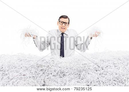 Powerless employee holding bunch of shredded paper isolated on white background