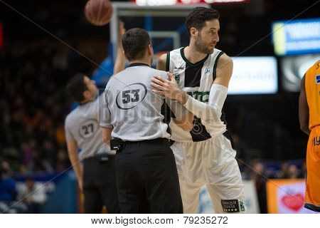 VALENCIA, SPAIN - DECEMBER 30: Vidal (R) and referee (L) during Spanish League match between Valencia Basket Club and Juventut at Fonteta Stadium on December 30, 2014 in Valencia, Spain